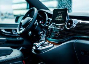 Luxury car interior details. Dashboard and steering wheel